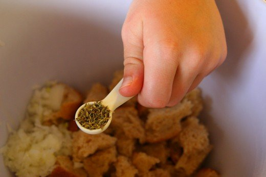 Add 1/4 teaspoon thyme and 1/8 teaspoon sage to the stuffing mixture. Mix until thoroughly combined.