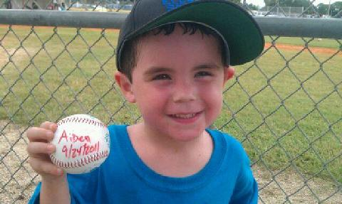 My 4 yr. old grandson's first baseball game.