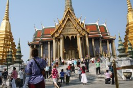 Men and women from different walks of life wondering about Thai architecture.