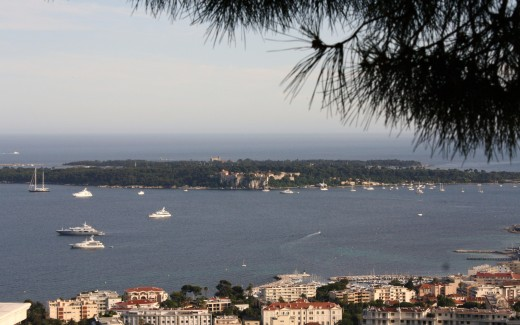 Les Lerins from Haute Cannes. St. Honorat is the farther, smaller island. The Man in the Iron Mask was imprisoned in the fort at front and center of Ile Ste. Marguerite in foreground.