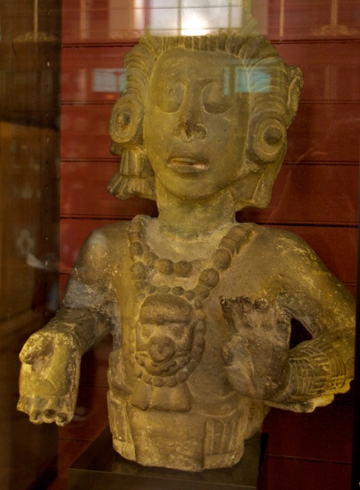 Maya maize god statue. Object 9 of 100. AD 175. Honduras. Stone. Am 1923, Maud 8. British Museum.