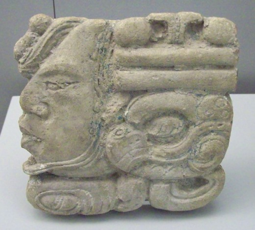 Stucco Maya glyphic cartouche from Palenque (Mexico). Late Classic Period (600–900 CE).