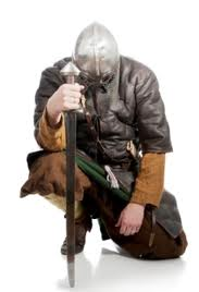 A man-at-arms at rest after surviving another battle - is he cursing or thanking Odin for not taking him?