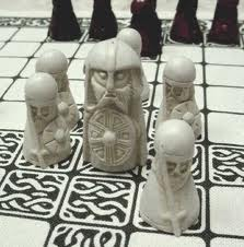 Table-top warfare. 'Hnefatafl', the king's table. The king must survive by reaching one corner. Black's challenge is to curtail the king's freedom by surrounding him on at least three sides of the board