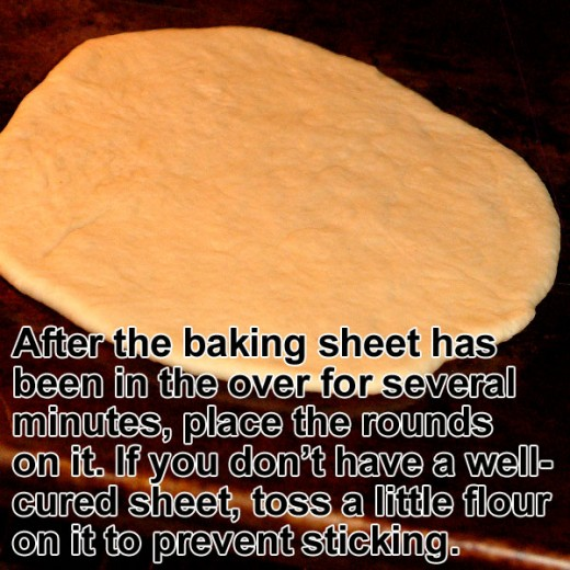 Place a baking sheet on the middle rack of the oven until it is hot. Then place the flat pita round on the screaming-hot sheet.
