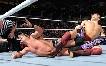 Chris Jericho desperately reaching for the salvation of the rope