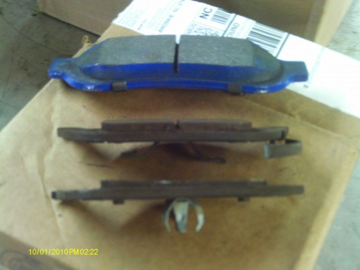 New brake pads (Blue) compared to old pads. The middle pad is the stationary side; the pad close to reader is the piston side-more wear.