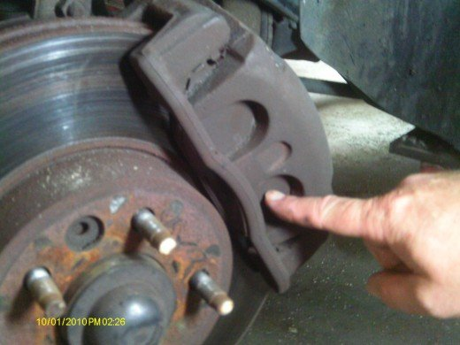 Brake pads are housed in the caliper