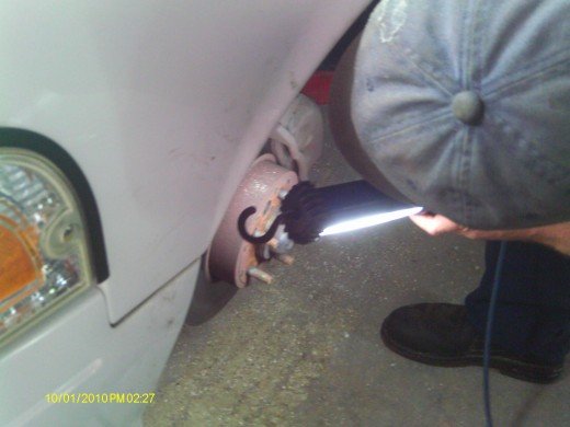 Use a light for optimal inspection of the condition of the brake system