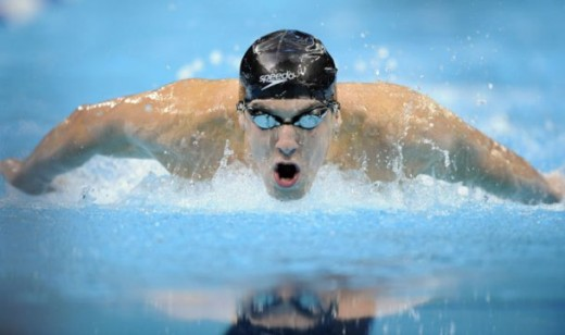 Competitive swimmers wear swim caps because better fluid dynamics can shave off milliseconds which could very well mean the difference between a gold and silver medal. In picture is Michael Phelps.