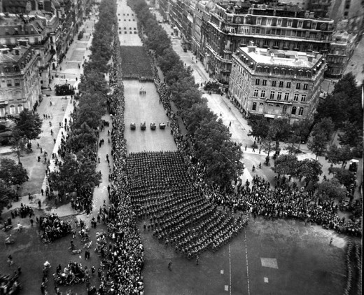 The American army as they march in review towards the Arc de Triomphe, celebrating the liberation of the capital of France from Nazi occupation. 29 August 1944