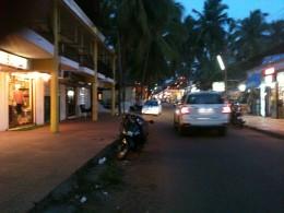Vehicles moving at a market near Candolim beach in Goa.