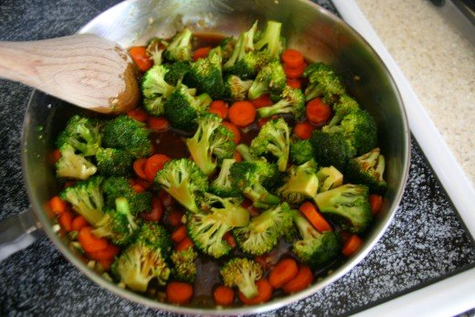 Add the water and stir fry sauce to the vegetables and cook for about 5 minutes, until the vegetables become slightly tender.