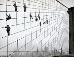 Men painting cables on the Brooklyn Bridge.