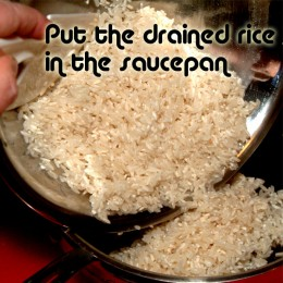 Put drained rice in the saucepan.