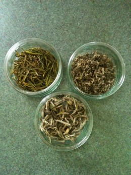 Clockwise from top left: Anji Bai Cha, Meng Ding Ganlu, and Baihao Yinzhen loose-leaf green and white teas