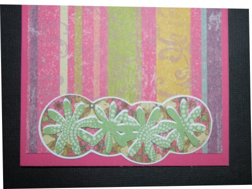 Daisy layers adhered to card