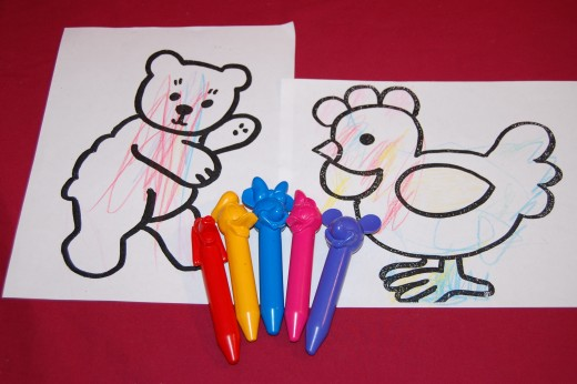 "Find ""indestructible"" large crayons, and encourage a few strokes.  Don't worry about how the child grasps the crayon."