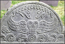 Death head gravestone found in Old Burial Hill graveyard in New England.