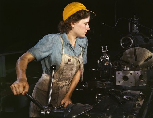 "A real-life ""Rosie"" at work operating a turret lathe (1942)"