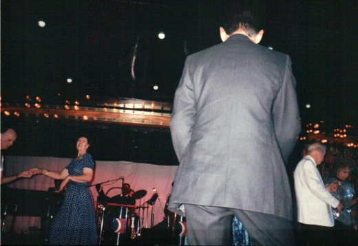 Other events such as the Captain's formal cocktail hour, which mostly includes dance music provided by the orchestra, can raise heck for your autistic child. This was taken at the former Carnival ship Tropicale in September, 1995.