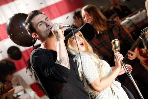 """Maroon 5 and Christina Aguilera perform in the """"Moves Like Jagger"""" music video."""