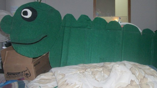 This is Charlie the Caterpillar he is made out of an old piece of cardboard box, glue and felt.