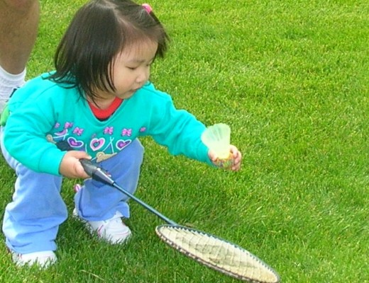 Kid playing badminton