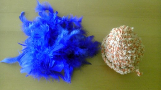 Bright feathers and specialty yarn make a cat toy to remember.