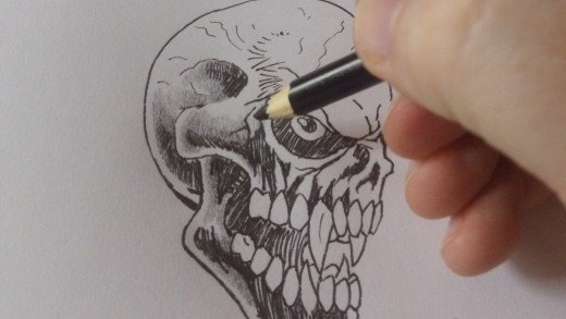 Using a black pencil creating tone around the important areas leaving certain areas white for highlights.