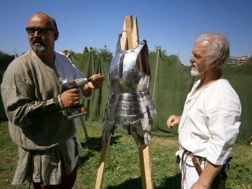 Experimentational archery. This armour is a replica of 1450's Milanese armour, made of double layered springsteel.not tempered but modern springsteel nonetheless.