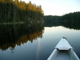 Unruffled clarity: a still summer night on Rosen Lake, British Columbia Rockies, British Columbia, Canada.