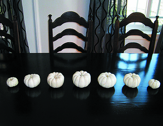 This pumpkin centerpiece is a perfect example of progression.