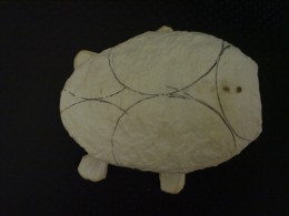 Picture 6: After being layered with thin paper. Look at the position of the holes where you'll hang the head.