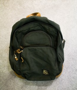 An old travel backpack that seems to survive the many travel adventures.