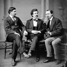 Group photo portrait of author and humorist Mark Twain (a.k.a. Samuel L. Clemens; middle), noted American Civil War correspondent and author George Alfred Townsend (left), and David Gray, editor of the Buffalo Courier (right).