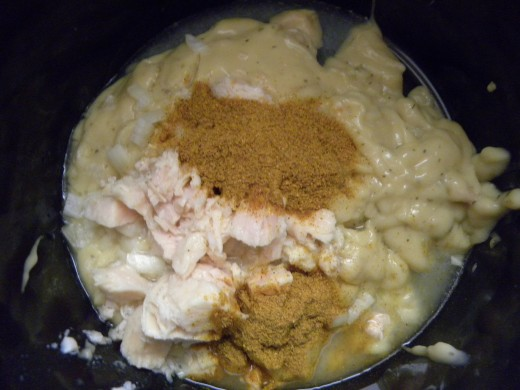 Chicken, cream of chicken soup, onions and curry powder in the crock pot ready to simmer for several hours. Sour cream is added the last 30 minutes.