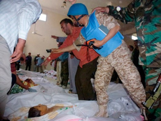 UN Observers take pictures of bodies of people killed in Homs during the Houla Massacre (Syria)