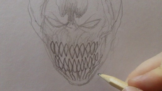 Darken the teeth with a 2B pencil.