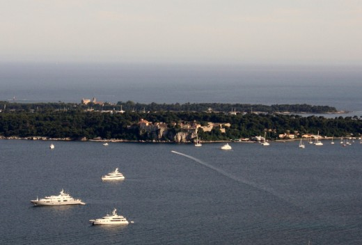 The Lerins Islands. Ste. Marguerite is at front with fortress near center. St. Honorat is close behind.