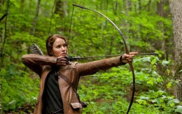 Jennifer Lawrence stars as Katniss Everdeen, a teen who must fight to survive in a brutal game show on a future Earth.