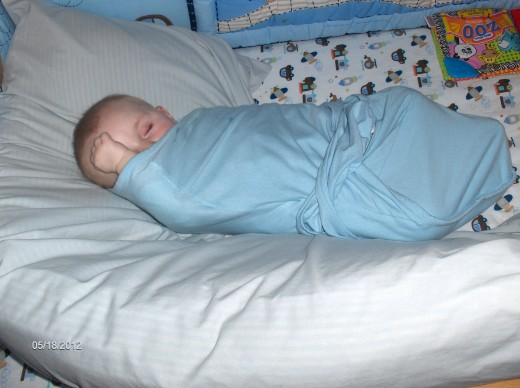 Baby with stuffy nose sleeps soundly in his swaddle.  Grammy still isn't a pro in the swaddling department.