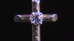 Mrs. Wu son's mortal remains was cremated and turned into diamonds which is locked up in her cross necklace.