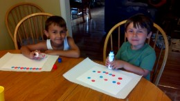My little cupcake assistants working hard on the wrappers.