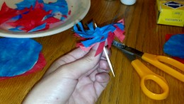 Insert toothpick in middle of circles and twist around. Add a small piece of tape to secure.