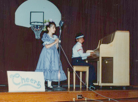 Me playing piano with my sister singing just a few years after getting started.