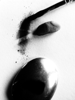 Hold an old spoon over a candle flame to make a useful deep dark value for shadow areas without graphite-shine.