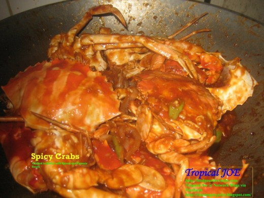 Spicy Crabs - cooked in butter, tomato sauce, with julliened carrots, bell peppers and spices