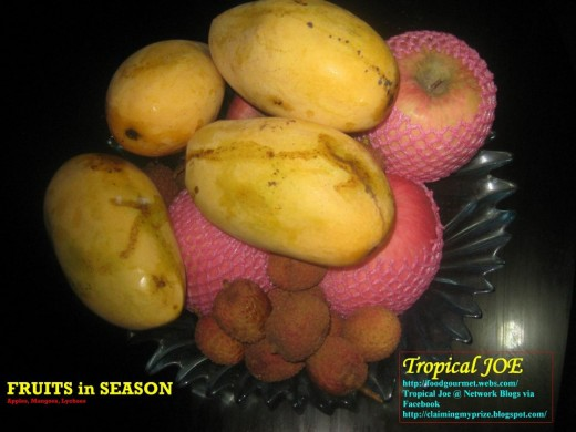 Fruits-in-season: a tray of Philippine mangoes with apples and lychees.