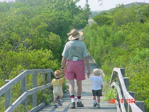 The boys taking a walk with Grandpa on vacation